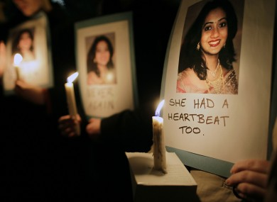 Protesters hold a vigil outside Leinster House in memory of Savita Halappanavar.