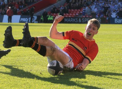 Liam Coombes celebrates scoring a try for CBC.