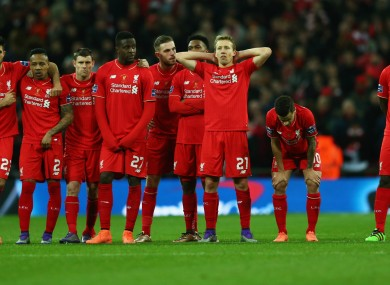 Liverpool stand dejected after losing the League Cup final.