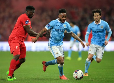 Liverpool's Kolo Toure (left) and Manchester City's Raheem Sterling battle for the ball during the Capital One Cup final.