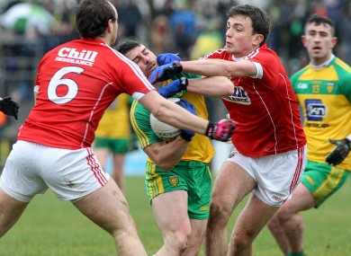 Donegal's Paddy McGrath tries to battle past the Cork duo of Mark Collins and Brian O'Driscoll.