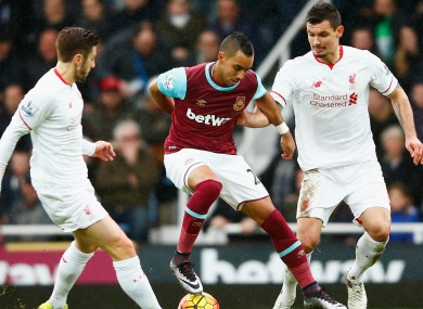 Dimitri Payet competing against Liverpool.