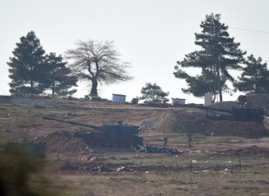 Turkish artillery fire from the border near Kilis toward northern Syria.