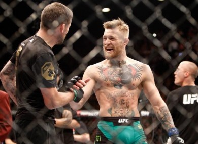 John Kavanagh and Conor McGregor celebrate following the win against Jose Aldo at UFC 194 in December.