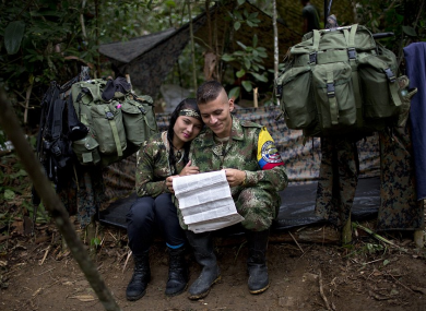 Farc rebel Juliana sits with her boyfriend, Alexis, in their makeshift tent.