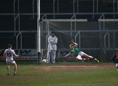 Neil Flynn slots home his penalty for Kildare.