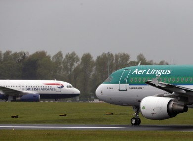 File photo of an Aer Lingus and a BA plane passing each other at Dublin Airport