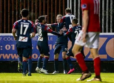The Sligo players celebrate at Richmond Park.