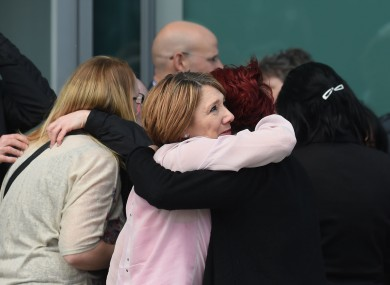 Justice: Familes of the 96 hug outside the Hillsborough inquests in Warrington.