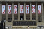 A giant banner is unveiled at St George's Hall in Liverpool after the inquest jury ruled the 96 victims in the Hillsborough disaster had been unlawfully killed.