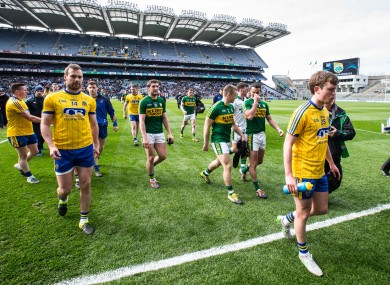 Roscommon players troop off after yesterday's defeat in Croke Park.