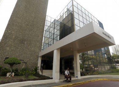 A security guard sits outside the Mossack Fonseca HQ in Panama City yesterday.
