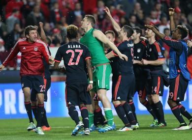 Munich players celebrate after the Champions League quarter-final second leg.