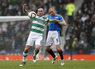 Brown battles with Rangers striker Kenny Miller in the recent Scottish League Cup semi-final at Hampden Park.