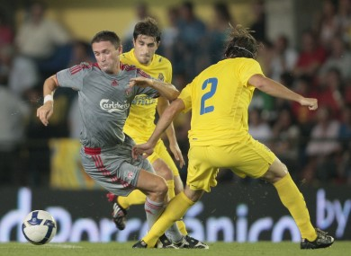 Robbie Keane facing Villarreal's Cani and Gonzalo Javier back in 2008.