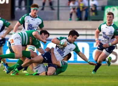 Connacht's Tiernan O'Halloran is tackled.