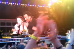 A young girl got to sing and take a selfie on stage with Springsteen in Croker last night