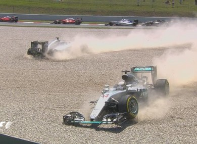 Hamilton and Rosberg: Mercedes team-mates collided before turn three.