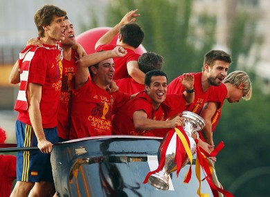 Pedro holds the trophy as his Spanish team-mates celebrate in 2012.