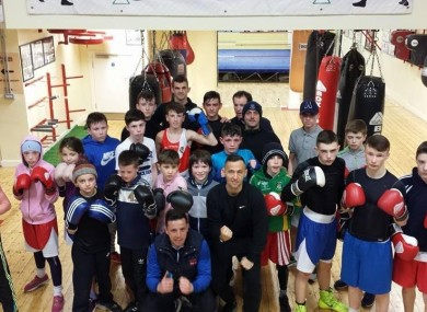 The coaches pose with some of the young fighters of Crumlin Boxing Club.