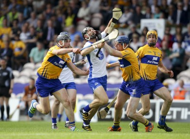 Maurice Shanahan tries to burst past the Clare defence.