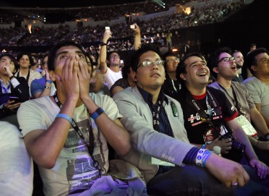 Audience members react to an announcement at Sony's Playstation 4 event last year.