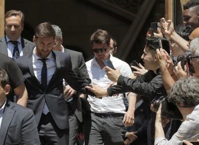 Barcelona soccer player Lionel Messi, left, leaves the court on Thursday.