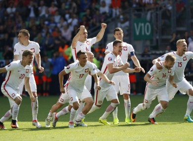 Poland's players celebrated after clinching victory.
