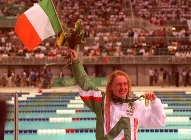 Michelle Smith flies the Irish flag at the Georgia Tech Aquatic Center after winning her second gold medal.