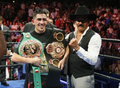 Santa Cruz celebrates his featherweight title win against Abner Mares in August 2015.