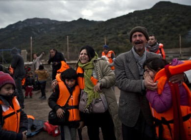 A family embraces after arriving on a vessel from the Turkish coast to the Greek island of Lesbos.