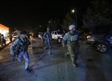 Afghan security forces rush to respond to a complex Taliban attack on the campus of the American University in the Afghan capital Kabul.
