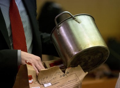 During the trial for Martin Blackwell a lawyer holds a pot they say Blackwell used to pour boiling water on his girlfriend's gay son and his friend as they slept.