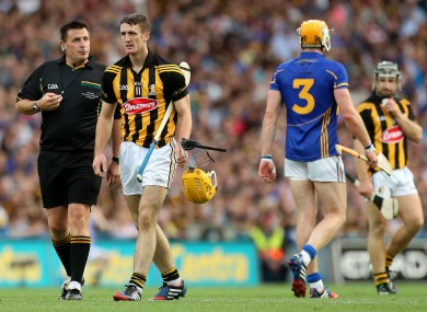 Referee Brian Gavin with Kilkenny's Colin Fennelly and Tipperary's Padraic Maher during the 2014 final replay.