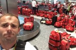 This photo of Olympians collecting their luggage at arrival is an absolute disaster