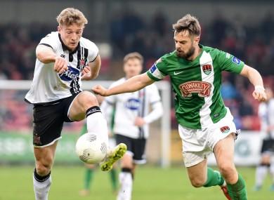 Cork City's Greg Bolger (right) challenging Dundalk's John Mountney at Turner's Cross earlier this season.