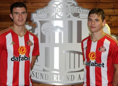 McNair and Love pose in Sunderland shirts.