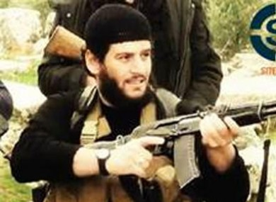 Undated militant image shows Abu Muhammed al-Adnani, the Islamic State militant group's spokesman, who IS say was