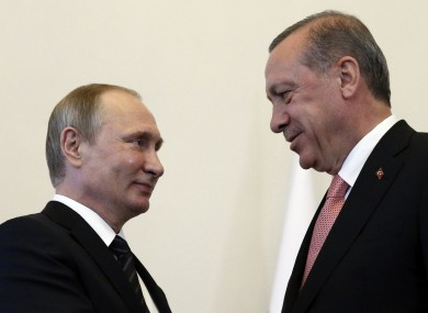 Russian President Vladimir Putin, left, welcomes Turkey's president Recep Erdogan in the Konstantin palace outside St Petersburg today.