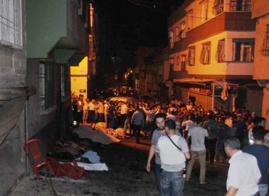 People gather after an explosion in Gaziantep, southeastern Turkey.
