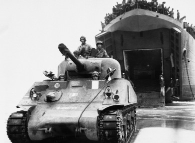 British soldiers drive an American tank on to a beach in Normandy, France on August 15, 1944, during the Second World War.