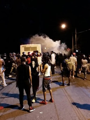 Police fire tear gas into the crowd of protesters on Old Concord Road in Charlotte.