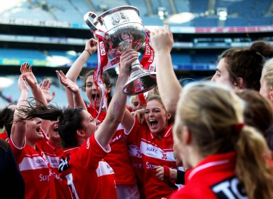 Cork captain Ciara O'Sullivan leads the celebrations with the Brendan Martin Cup.
