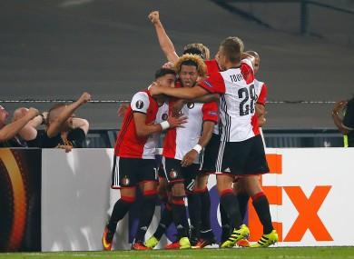 Feyenoord's Tonny Trindade, centre, celebrates after scoring the opening goal.