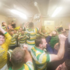 Carbery Rangers celebrate with the trophy in the dressing room.<span class=