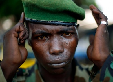 A Seleka Presidential Guardsman adjusts his beret at the downtown market in Bangui, Central African Republic.