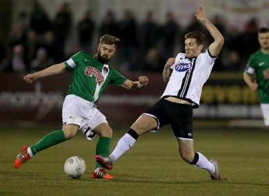 Greg Bolger and Patrick McEleney battle for the ball when Dundalk and Cork met earlier this year.