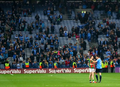 Bernard Brogan consoles Keith Higgins after yesterday's game.