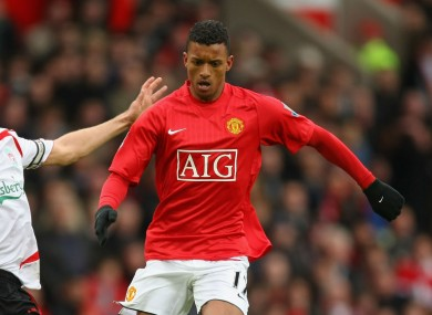 Manchester United winger Nani tackled by Liverpool captain Steven Gerrard