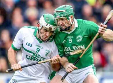 Paddy Deegan and Henry Shefflin in action.
